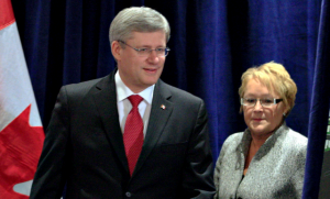 "Harper: I thought you said that persecuting minorities would work!""  Marois: Yes, but you disagreed with me at the time."