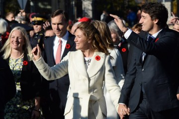 Prime Minister-designate Justin Trudeau and his wife Sophie Gregoire-Trudeau lead the new Liberal cabinet to Rideau Hall in Ottawa on Wednesday, Nov. 4, 2015. THE CANADIAN PRESS/Sean Kilpatrick