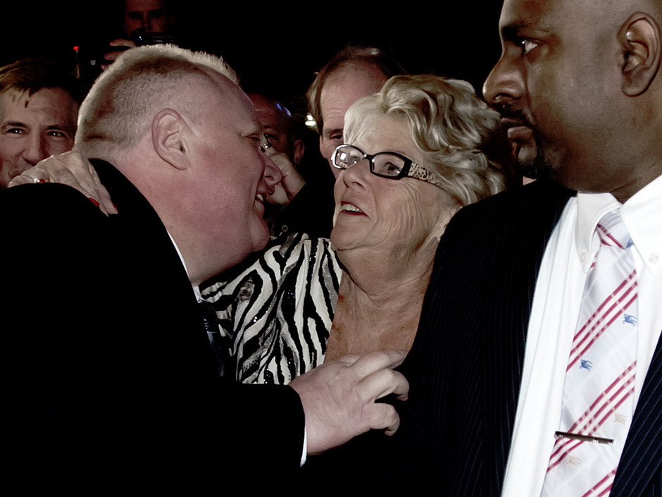 Rob Ford, seemingly clawing his mother at his grand campaign launch Thursday night, Peter J. Thompson / National Post http://news.nationalpost.com/2014/04/17/youve-always-had-my-back-rob-ford-kicks-off-campaign-with-bobble-head-filled-party/
