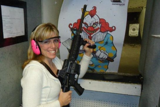 The accused adulteress, taking aim at her second favourite clown.Facebook