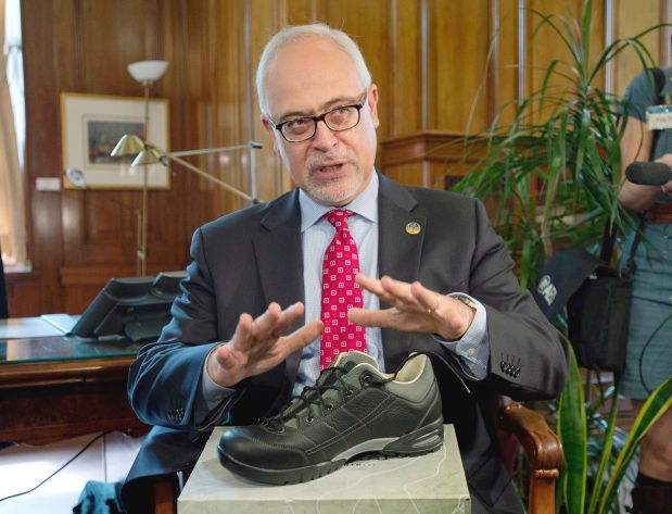 He actually talked about shoes instead of the budget. This is not parody. He actually did this.Jacques Boissinot