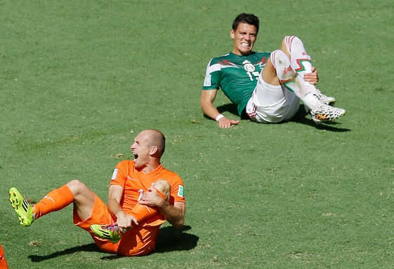 The World Cup has seen its share of Shakespearean performances by falling players howling in pain to impress the referee. Here, The Netherlands' Arjen Robben, left, and Mexico's Hector Moreno put on the act.Themba Hadebe